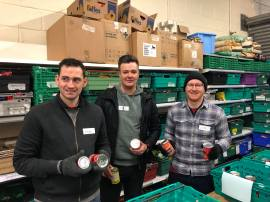 volunteers sorting out the tins of soup in the warehouse